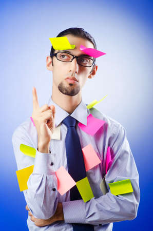 Young businessman with reminder notes Stock Photo - 10571986
