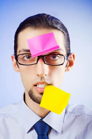 Young businessman with reminder notes Stock Photo - 10572743