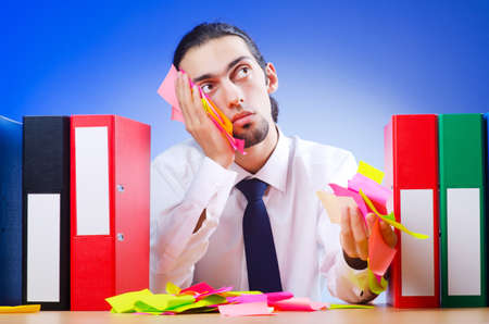 Businessman with many office folders Stock Photo - 10571940