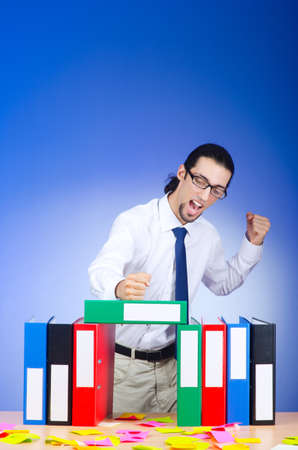 Businessman with many office folders Stock Photo - 10572711