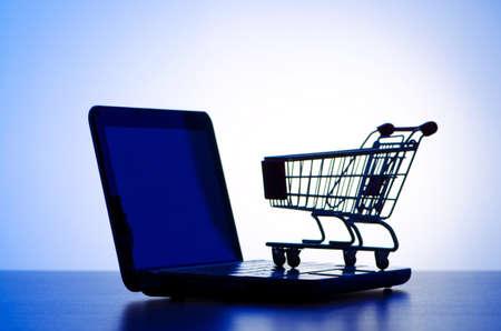 Shopping cart against gradient photo