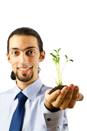 Young student holding green seedlings on white Stock Photo - 10572797