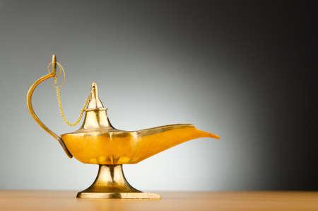 an oil lamp: Antigua lámpara contra fondo degradado
