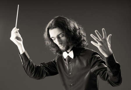 Music concept with passionate conductor photo