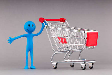 Shopping cart and happy smilies photo