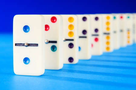 business symbols metaphors: Domino effect with many pieces Stock Photo
