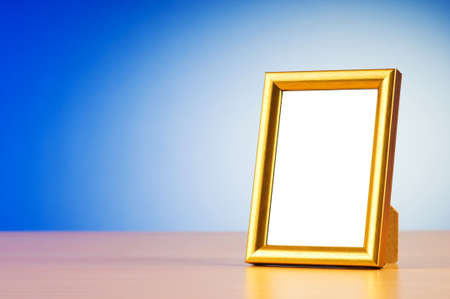 gilt: Wooden picture frames on the gradient background