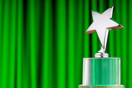 Star award against curtain background Stock Photo - 10560851