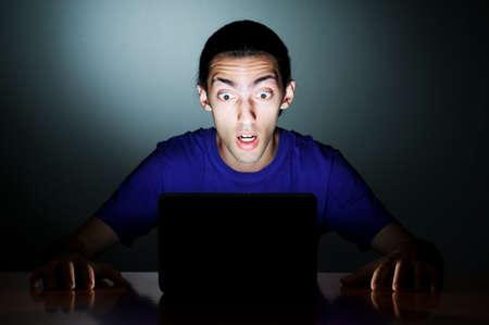 Hacker sitting in dark room Stock Photo - 10660170