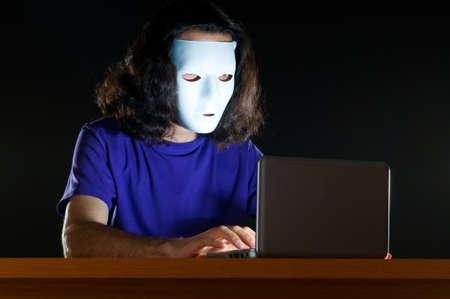 Hacker sitting in dark room Stock Photo - 10619855