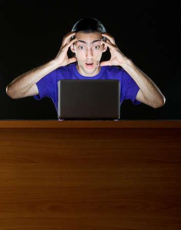 Hacker sitting in dark room Stock Photo - 10660176