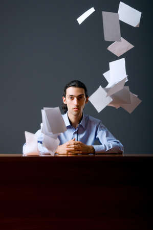 man flying: Flying paper and businessman in office