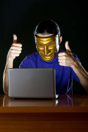 Hacker sitting in dark room Stock Photo - 10619903