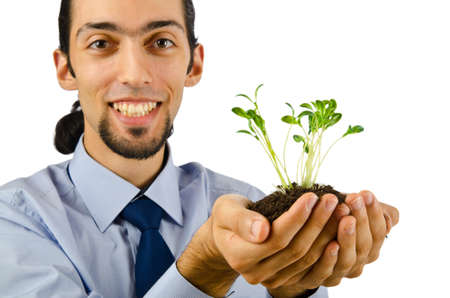 Young student holding green seedlings on white Stock Photo - 10661030