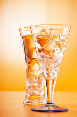 Water in the glass against gradient background photo