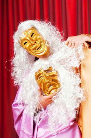 Theater concept with masked actor  photo