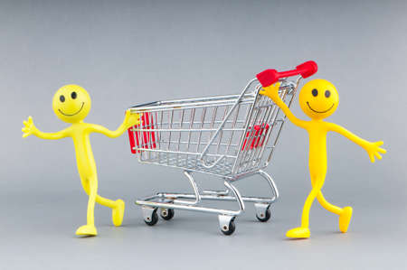 Shopping cart and happy smilies Stock Photo - 10615151