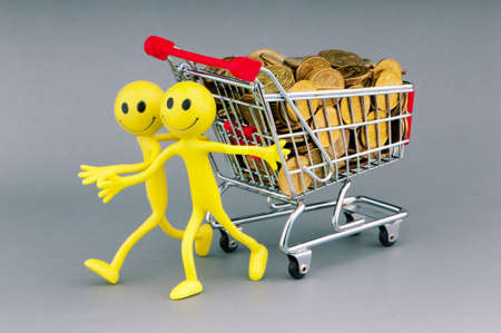 Smilies with shopping carts and coins photo