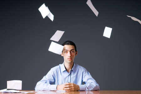 Flying paper and businessman in office photo