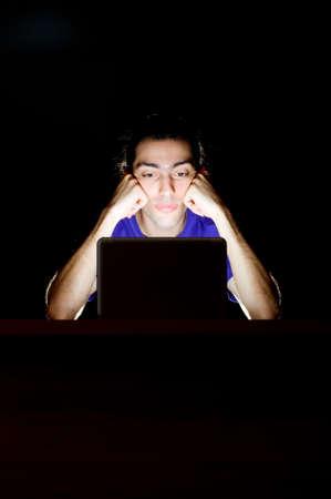 Hacker sitting in dark room Stock Photo - 10674175