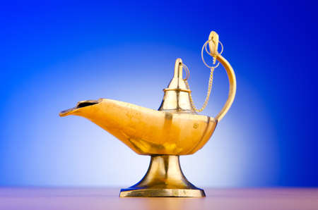 Ancient lamp against gradient background Stock Photo