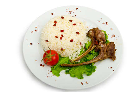 Lamb ribs with rice served in the plate photo
