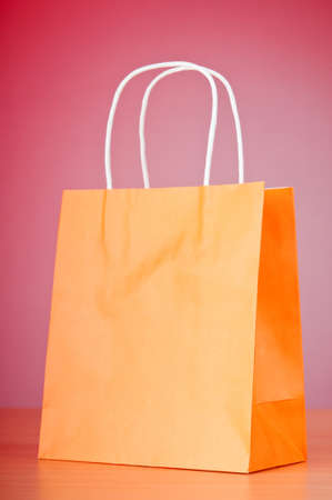 paper container: Shopping bags against gradient background Stock Photo