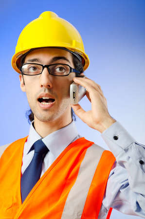 Young construction worker with hard hat Stock Photo - 10674380