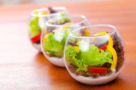 Fresh healthy salad in bowls