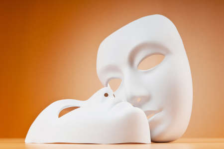 Theatre concept with masks against background photo