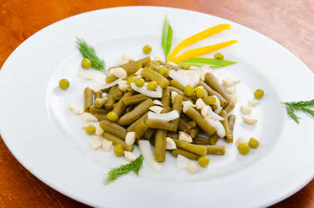 Green bean salad in the plate photo