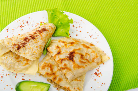 Pancakes stuffed with minced meat photo