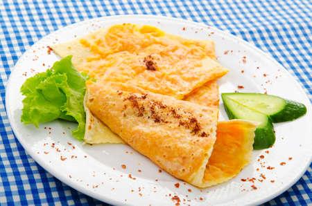 Pancakes stuffed with mashed pumpkin photo