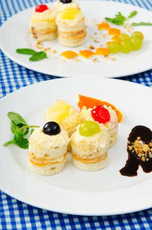Plate full of tasty mini cakes Stock Photo - 10660646