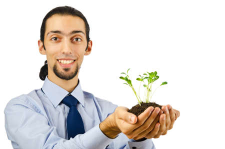 Young student holding green seedlings on white Stock Photo - 10700490