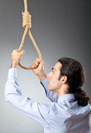 Businessman with thoughts of suicide Stock Photo - 10700526