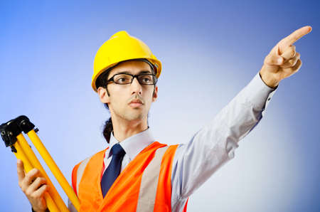Young construction worker with hard hat photo