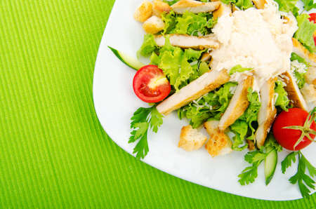 Ceasar salad in the plate photo
