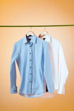 striped shirt: Shirt hanging on the hanger