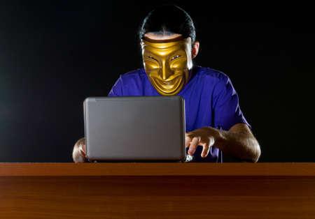 Hacker sitting in dark room Stock Photo - 10708055
