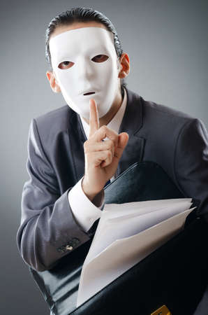 impostor: Industrial espionate concept with masked businessman Stock Photo