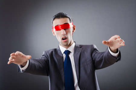 blinded: Businessman blinded by red tape