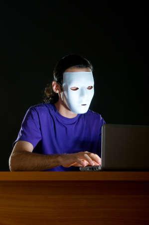 Hacker sitting in dark room photo