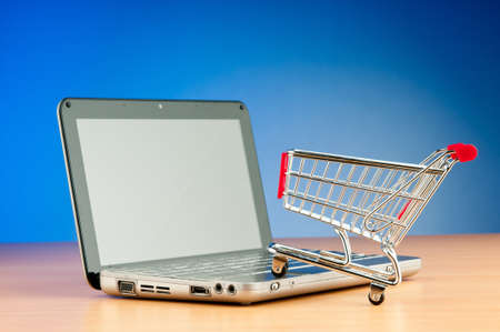 Internet online shopping concept with computer and cart Stock Photo - 10792151