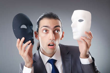 hypocrisy: Industrial espionate concept with masked businessman Stock Photo