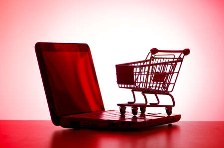 Shopping cart and laptop photo