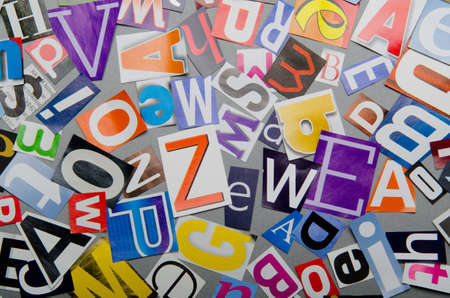 Cut letters from newspapers and magazines Stock Photo