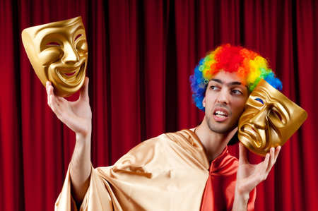 Actor with maks in a funny theater concept photo