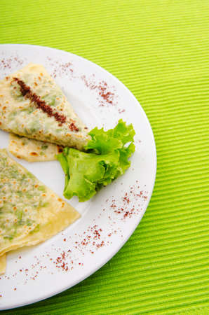 Pancakes stuffed with various herbs photo