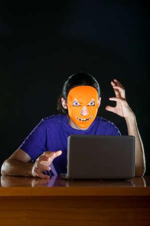 swindle: Hacker sitting in dark room